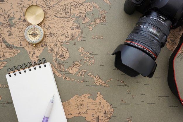Retro world map background with blank notebook and camera photo retro world map background with blank notebook and camera free photo gumiabroncs Choice Image