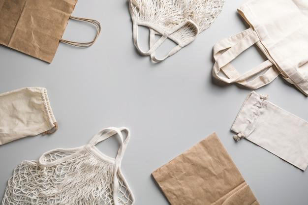 Reusable mesh, cotton and net bag for zero waste lifestyle on grey. Premium Photo