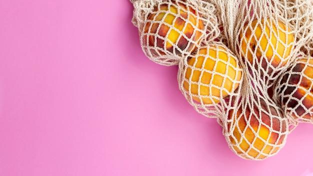 桃の再利用可能なショッピングメッシュバッグ 無料写真