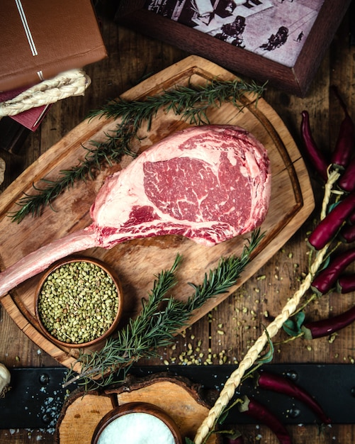 Rib eye steak on wooden board Free Photo