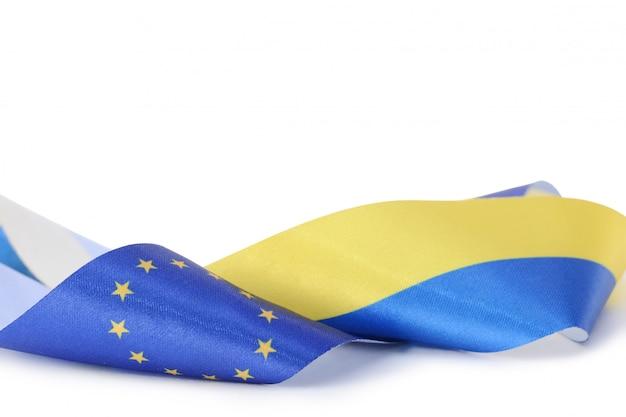 Ribbon with ukrainian and european union flags isolated Premium Photo
