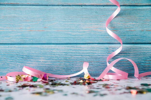 Ribbons and confetti on blue wood Free Photo