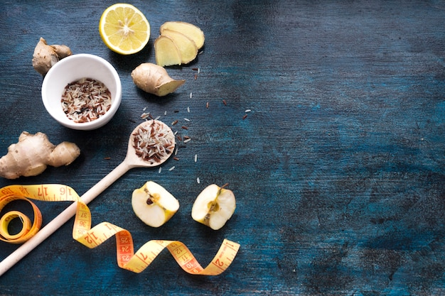 Rice in bowl with apples and measuring tape Free Photo