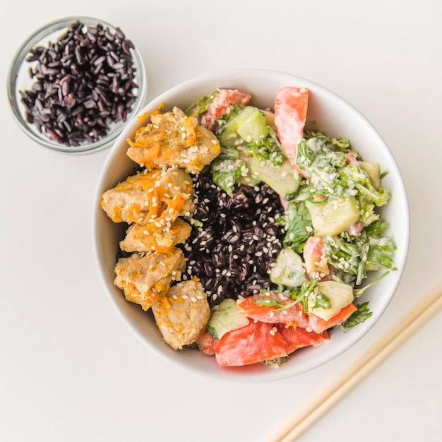 Rice bowl with seafood and vegetables Free Photo