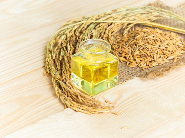 Premium Photo | Rice bran oil on wooden background. food and healthcare  concept.