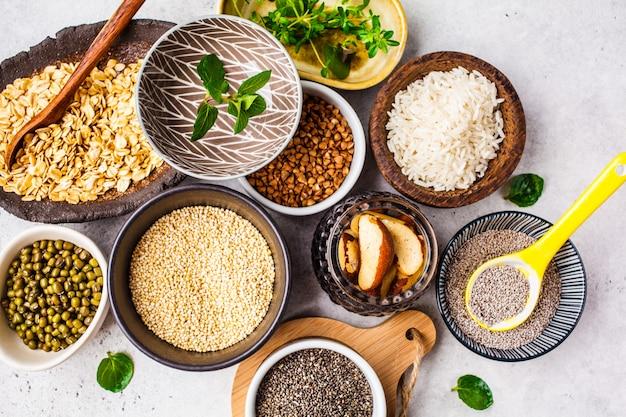 Rice, chia seeds, nuts, oatmeal, buckwheat, quinoa, mung beans and greens Premium Photo
