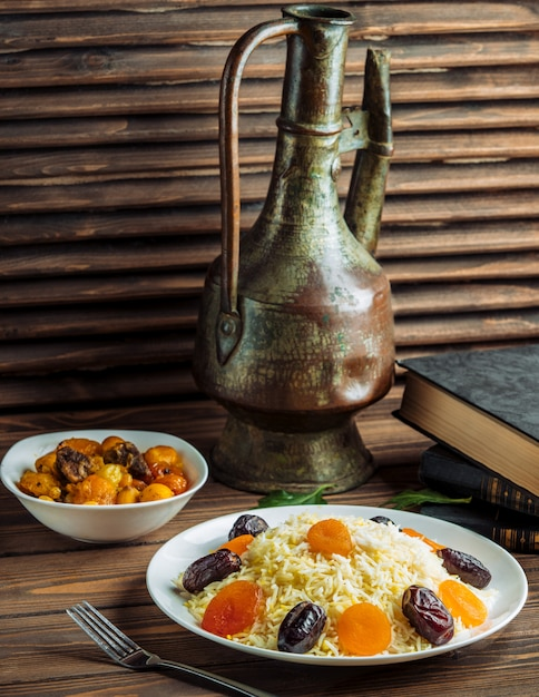 Rice garnish with dates, nuts and dry fruits Free Photo