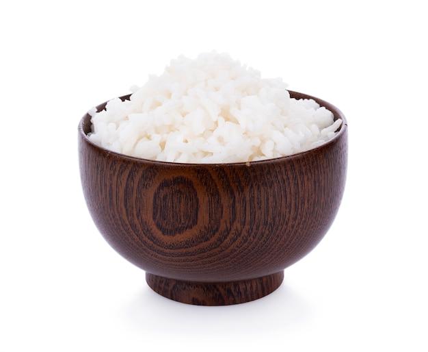 Рис в миске на белой поверхности Premium Фотографии