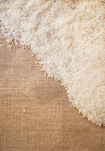 Rice on sackcloth use for background Premium Photo