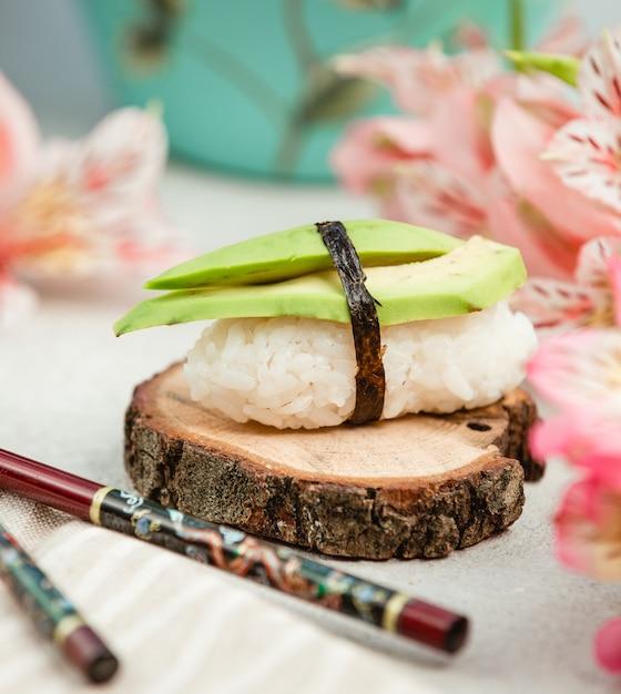 Rice sushi with avacado Free Photo