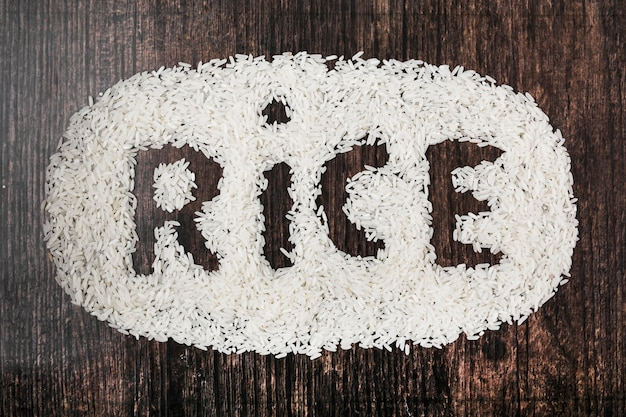Rice text on black wooden textured background Free Photo