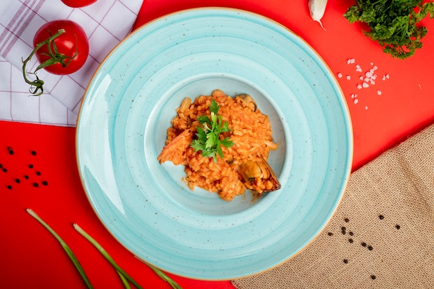 Rice in tomato sauce with sea food Free Photo