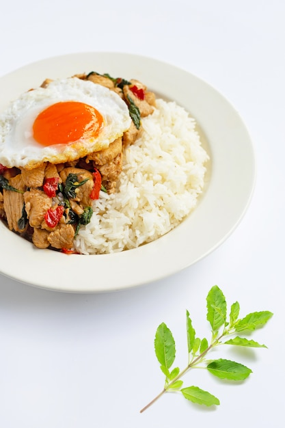 Rice topped with stir-fried chicken and holy basil Premium Photo