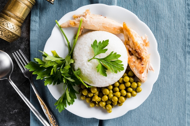 Rice with chicken breast and peas Free Photo