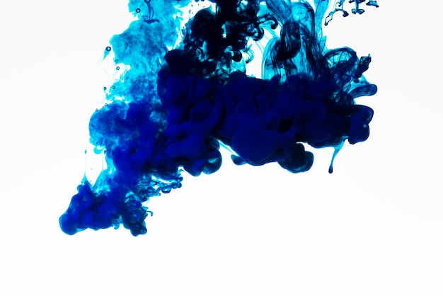 Rich blue colored ink droplet Free Photo