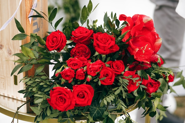 Rich Bouquet Made Of Red Roses Stands Outside Photo Free Download