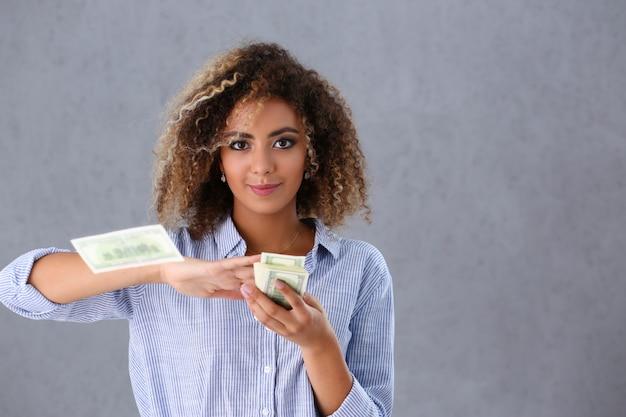 Rich pretty woman with cash Premium Photo