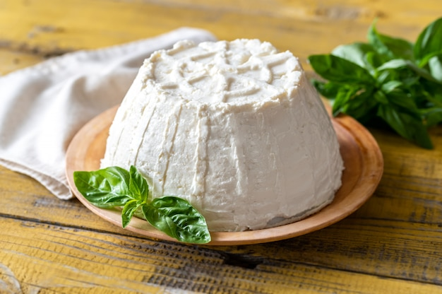 Frozen ricotta on a plate with fresh basil