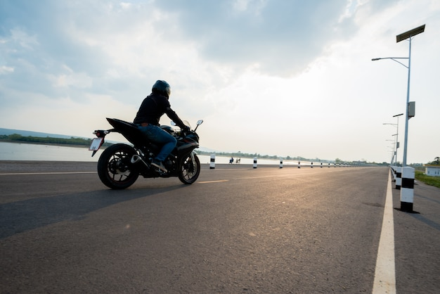 Rider motorbike on the road riding. having fun driving the empty road Free Photo