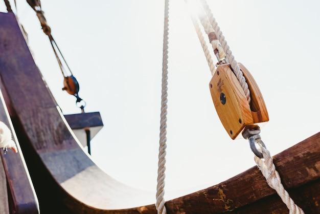 Rigging and ropes on an old sailing ship to sail in summer. Premium Photo
