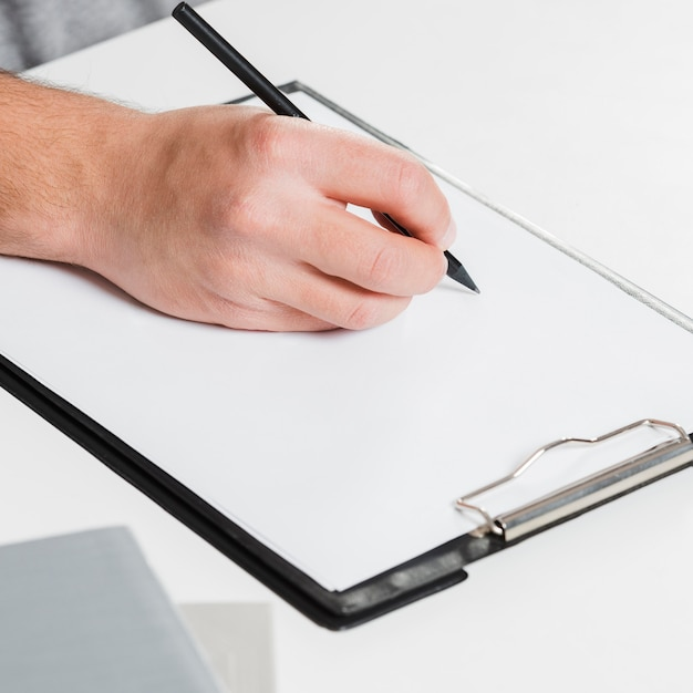 Right-handed person and copy space paper Premium Photo
