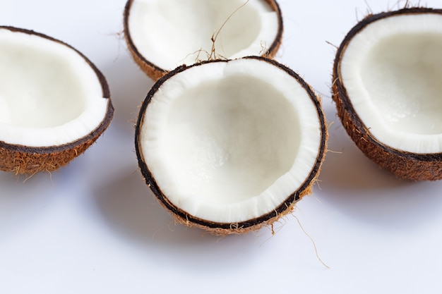Ripe coconuts on white. top view of tropical fruit. Premium Photo