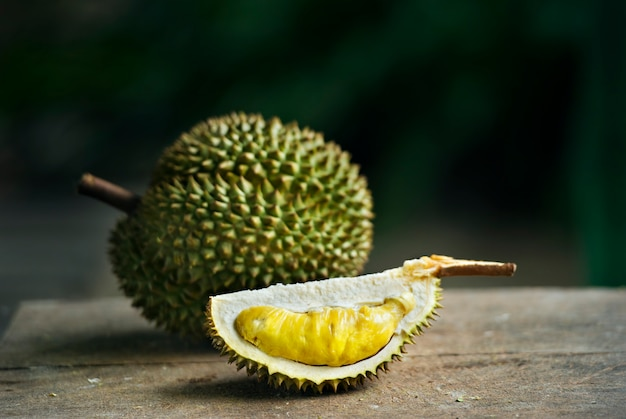 Ripe durian on table under tree shadow in the garden background Premium Photo