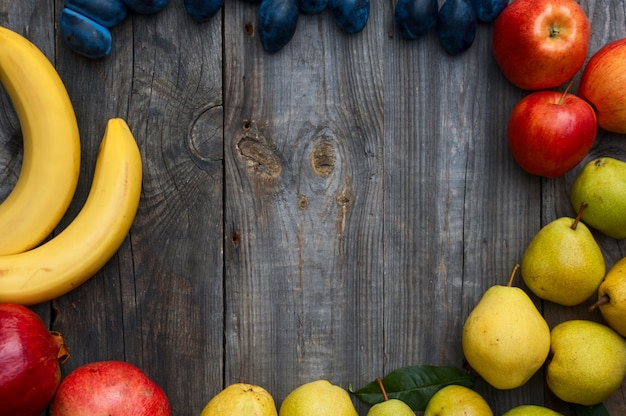 Ripe fruit on wooden background Premium Photo