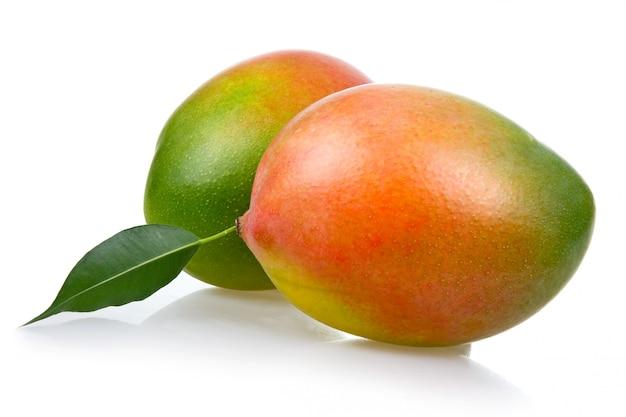Ripe mango fruits with leaves isolated on white background Premium Photo