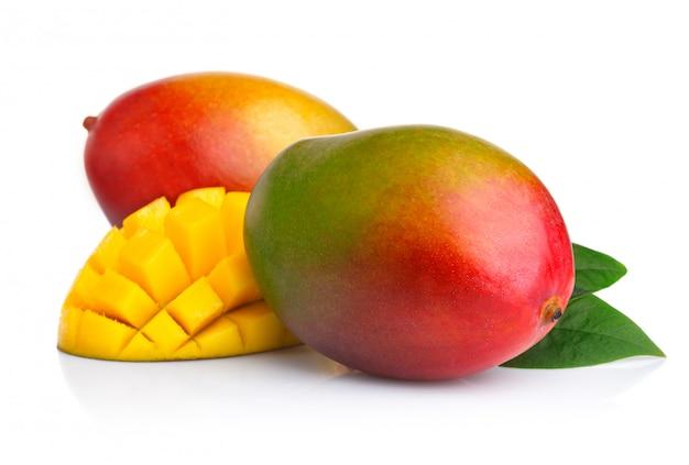 Ripe mango fruits with slices isolated on white Premium Photo