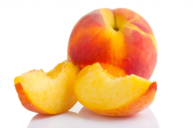 Ripe peach fruit with slices isolated on white Premium Photo