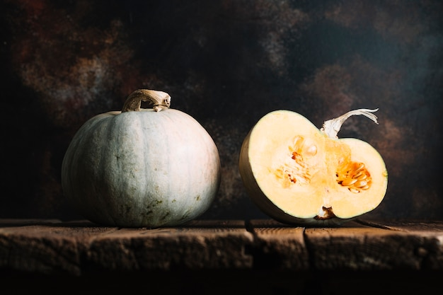 Ripe pumpkins on a wooden table Free Photo