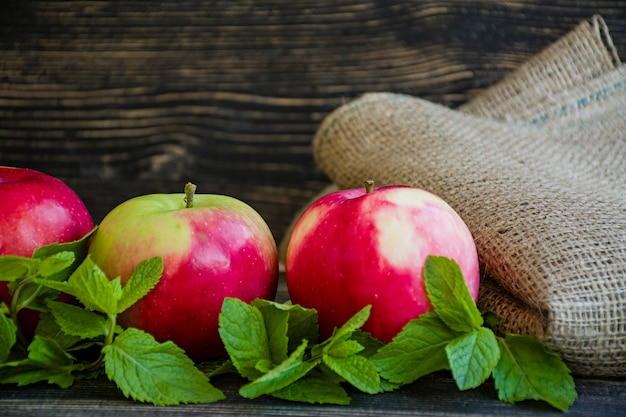 Ripe red apples with mint. Premium Photo