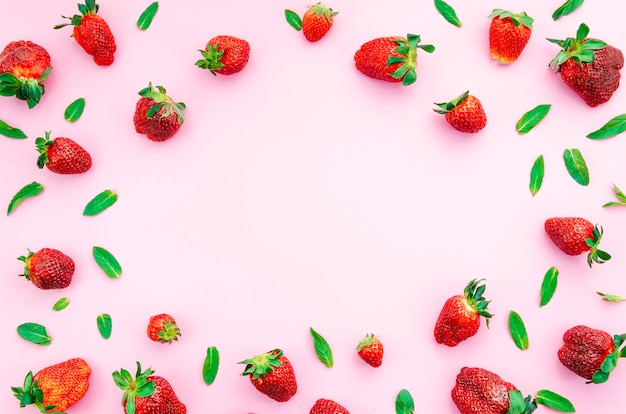 Ripe red strawberries and green leaves Free Photo