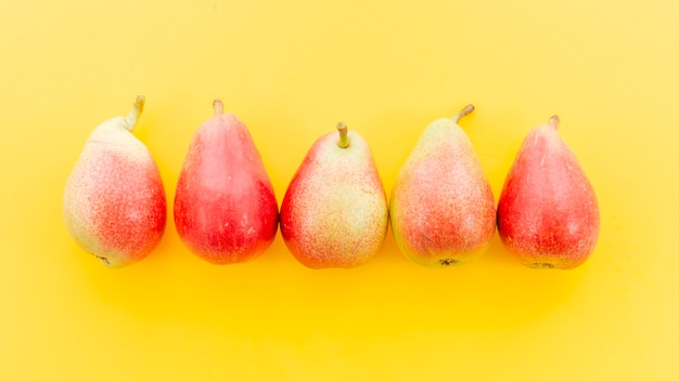 Ripe red whole pears in row Free Photo