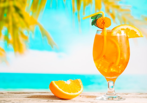 Ripe sliced orange and glass of juicy citrus drink Free Photo