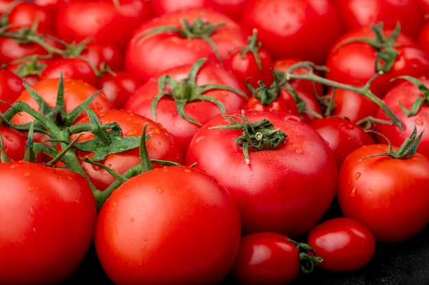 Free Photo | Ripe tomatoes with water drops as background side view
