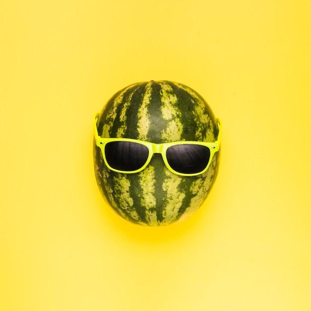 Ripe watermelon in dark sunglasses Free Photo