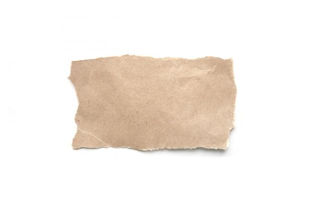 Разорвал старинный фон бумаги. сорванная коричневая бумага на белизне. Premium Фотографии