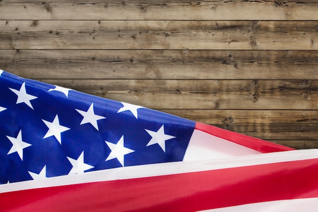 Rippled usa flag for fourth of july on wood Premium Photo