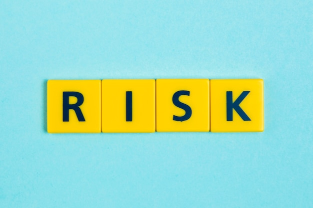 Risk word on scrabble tiles Free Photo