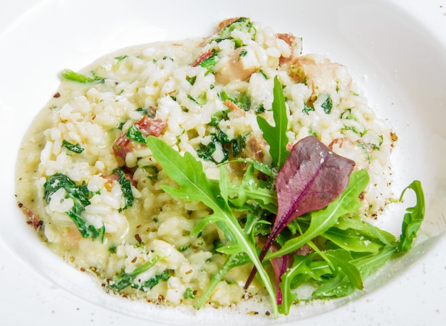 Risotto with smoked meat, spinach, parmesan cheese Free Photo