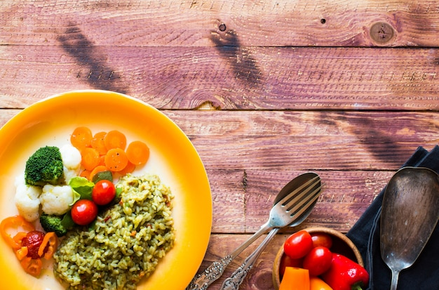 Risotto with vegetables, on wooden  background Premium Photo