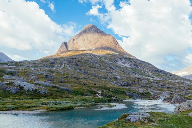 River flowing below the rock mountain landscape Free Photo