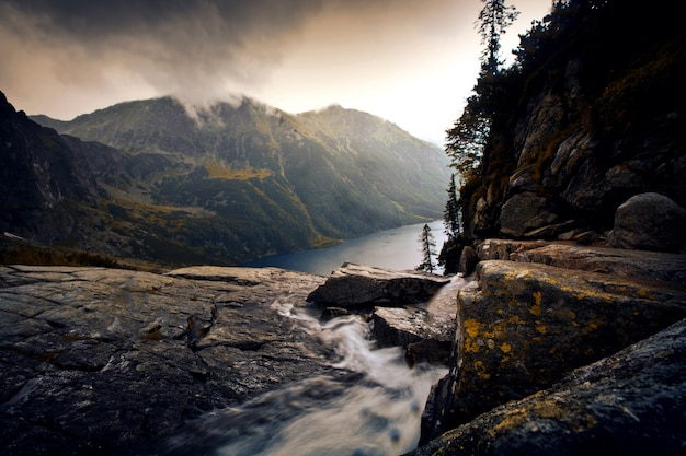 River in foggy mountains landscape. Free Photo