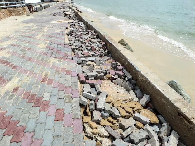 Road boardwalk damaged by storm surge Premium Photo