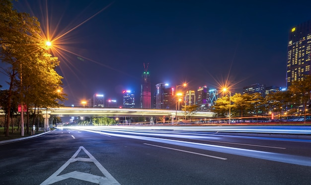 Road city nightscape architecture and fuzzy car lights Premium Photo