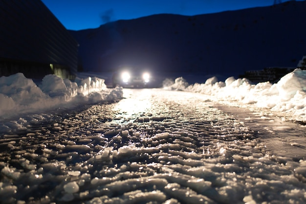 Road covered with ice in the headlights Premium Photo