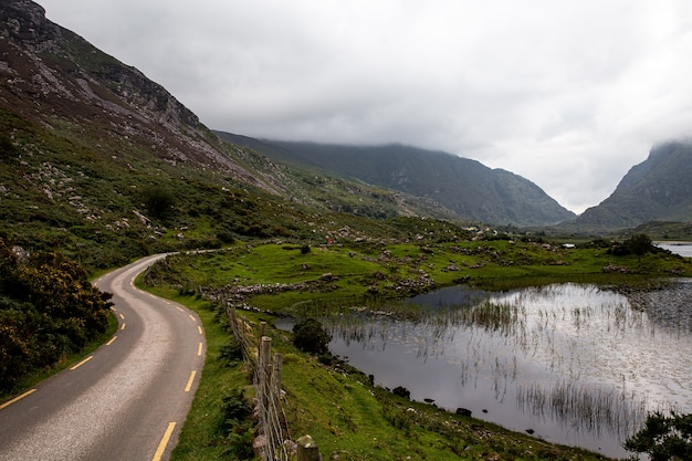 Road leading into gap of dunloe with augher lake beside it. ring of kerry. Premium Photo