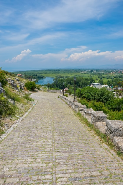 The road made of cobblestones to the ancient fortress of rozafa Premium Photo